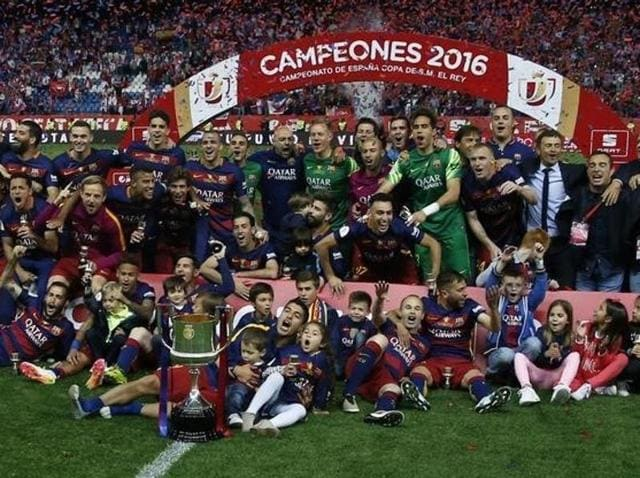 Barcelona players celebrate after winning the Copa del Rey final match against Sevilla.