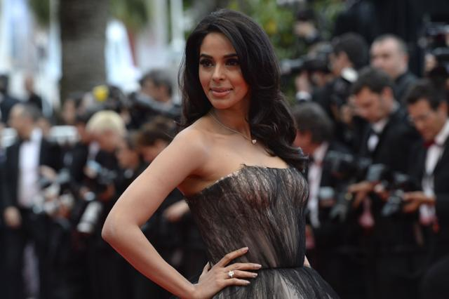 Actor Mallika Sherawat talks about walking the red carpet at Cannes Film Festival and her upcoming Chinese production.