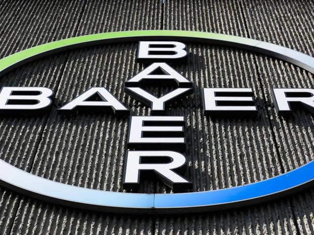 The Bayer AG corporate logo is displayed on a building of the German drug and chemicals company in Berlin, Germany.