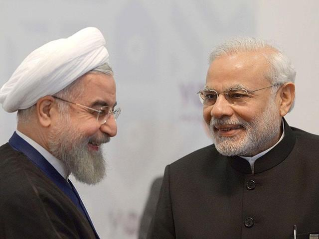 Iran's President Hassan Rouhani (L) meets with PM Modi in Ufa on the sidelines of a summit of the BRICS.  As the two leaders look at renewed ties, energy and infrastructure investments are high on the agenda.