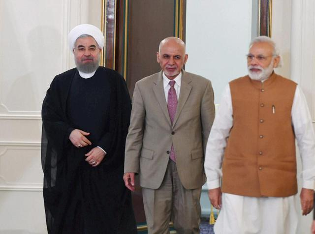 Prime Minister Narender Modi with Iranian President Hassan Rouhani and Ashraf Ghani, President of Afghanistan during agreement signing and press statement after Trilateral meeting at Talar building.