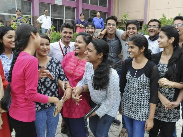 Students of CBSE Class 12 celebrating after declaration of their result in Patna on Saturday.