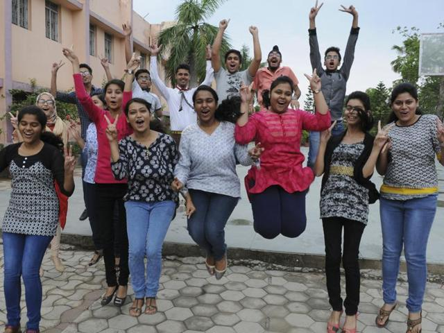Students of CBSE class 12th celebrate after declaration of their results in Patna.