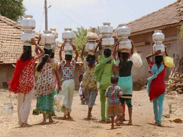 Villagers carrying water collected from a a water tanker in drought-hit Shahpur of Maharashtra.