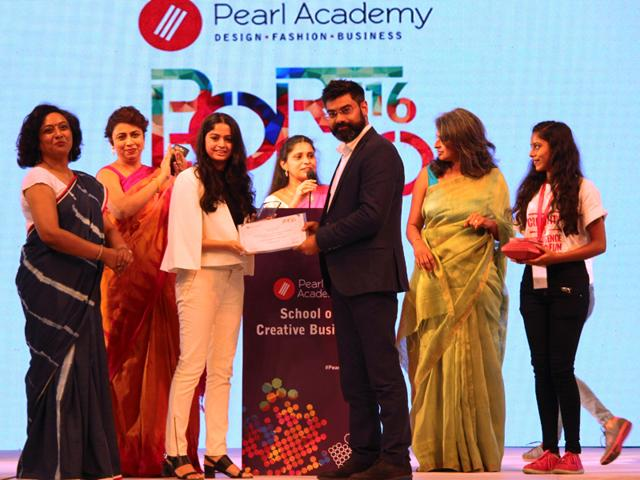 Rutvika Baradiya , receiving her award for Best Project in Marketing.