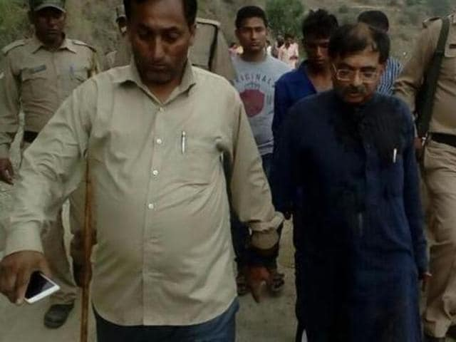 BJP's Tarun Vijay (centre) being escorted by policemen after an attack on him last Friday. (HTPhoto)