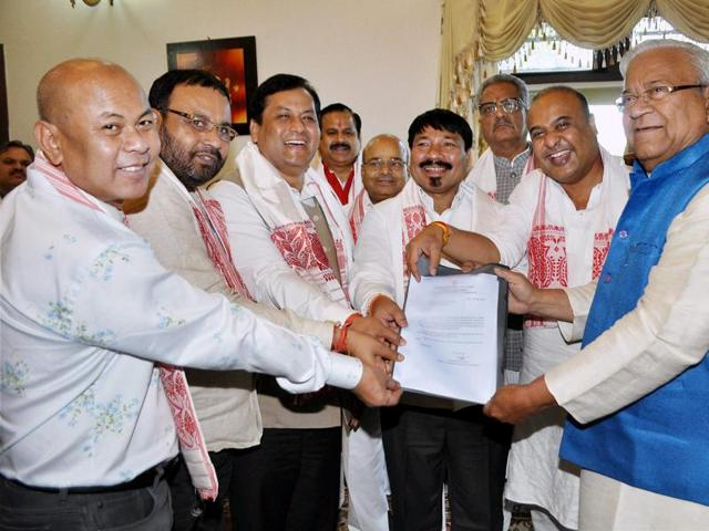 Assam chief ministerial candidate, Sarbananda Sonowal, along with alliance partners, presents the governer with a formal letter requesting to form government.