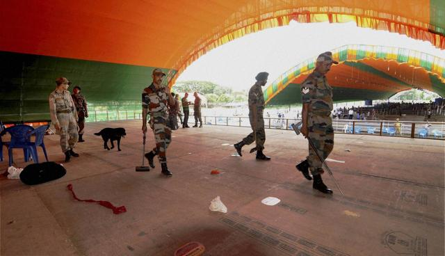 Army men check the venue for the ceremony of Sarbananda Sonowal's oath-taking as the new CM of Assam in Guwahati on Monday.