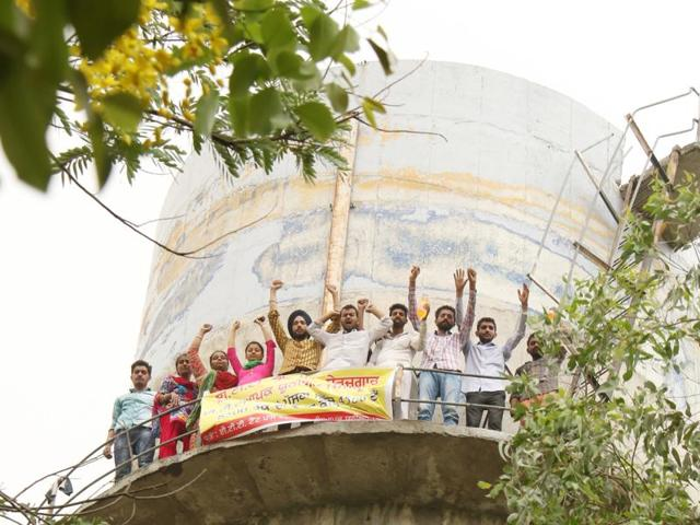Members of unemployed teachers' body protesting atop a water tank in Jai Singh Wala village in Bathinda on Monday.