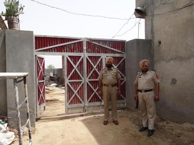 Police deployed outside the house from where the gangsters fled in a cop's car at Butter Kalan village in Moga district on Tuesday.