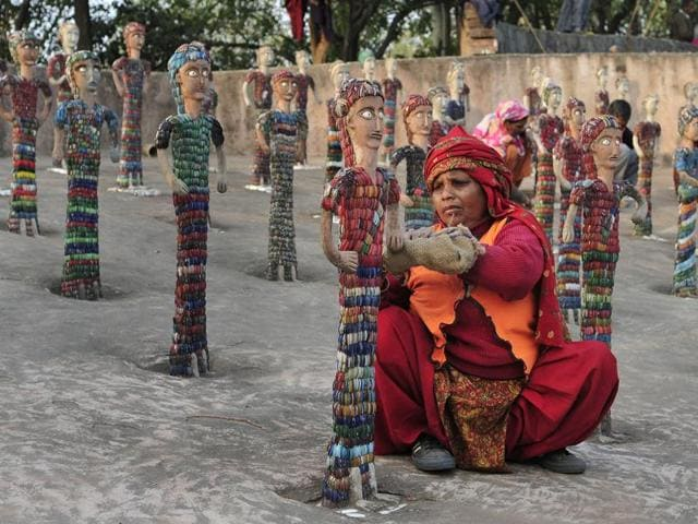 In this file photo, a woman is seen decorating the Rock Garden in Chandigarh.