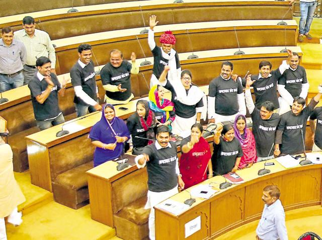Congress councillors in black T-shirts protest at the JMC's general body meeting in Jaipur on Tuesday.