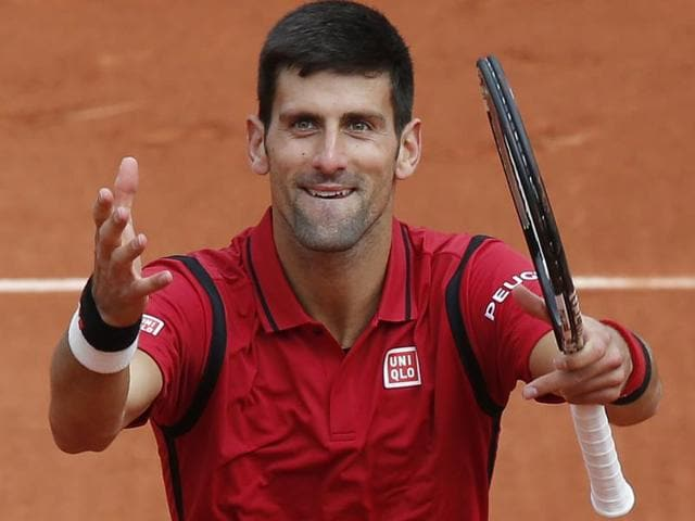 Serbia's Novak Djokovic acknowledges the cheering crowd after winning his first round match.