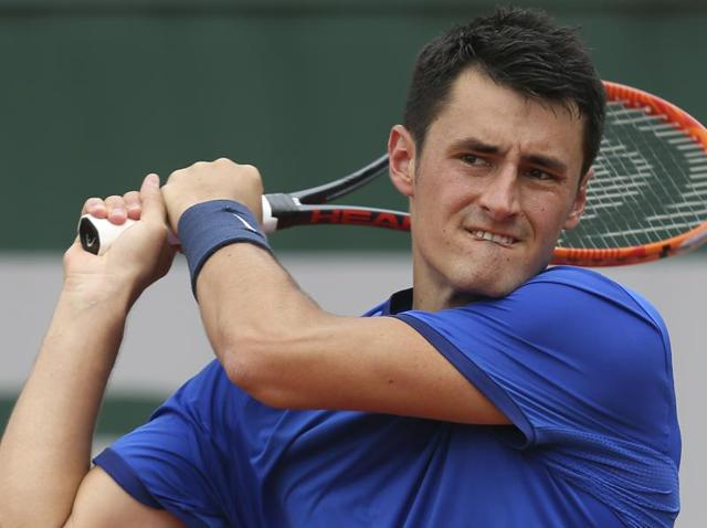 Australia's Bernard Tomic returns in his first round match of the French Open tennis tournament.