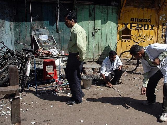 In this file photo, forensic experts can be seen searching for clues at the blast site in Malegaon.