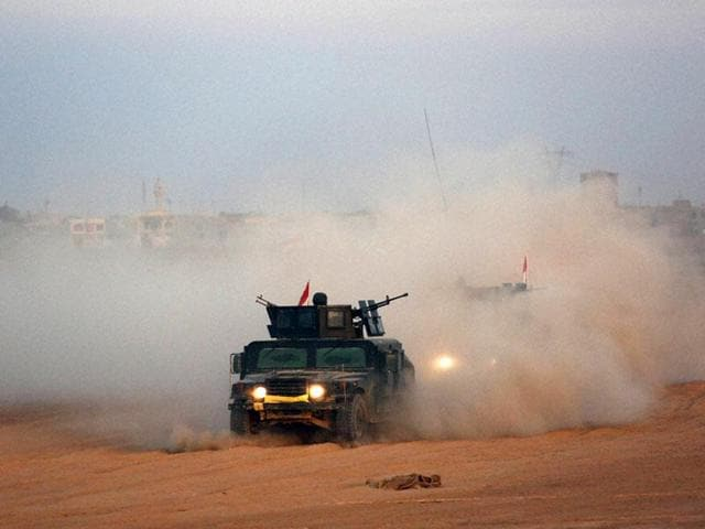 Pressure mounted on the Islamic State group on Tuesday, as a Kurdish-Arab alliance launched a major assault north of the jihadists' Syrian bastion of Raqa and Iraqi forces advanced on their stronghold of Fallujah.