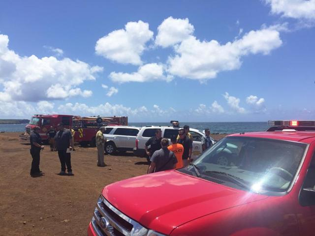 This photo provided by Kauai County shows emergency response vehicles near the site of a plane crash in Hanapepe, Hawaii.