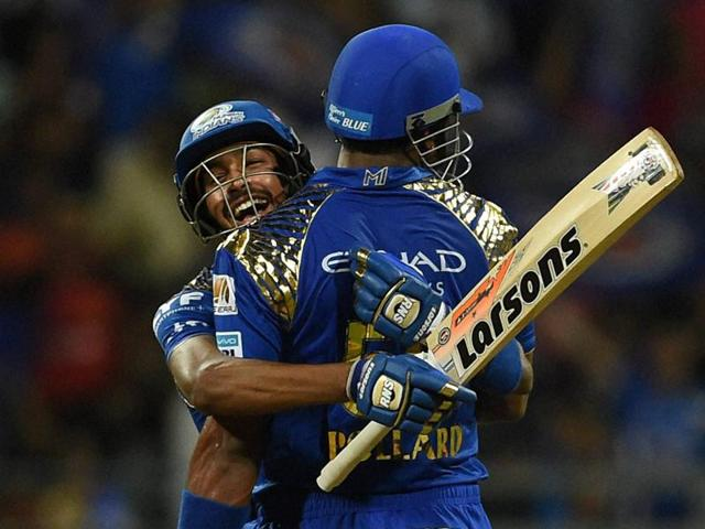 Mumbai Indians players Hardik Pandya and Kieron Pollard celebrate after the victory over Royal Challengers Bangalore during the IPL match in Mumbai on April 21.