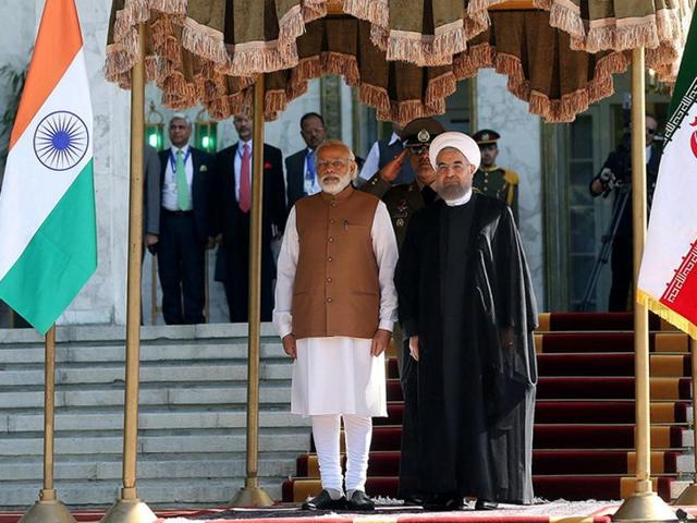 Prime Minister Narendra Modi interacts with Iranian President Hassan Rouhani during a joint press conference at the Saadabad Palace in Tehran.