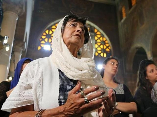 Relatives of the Christian victims of the crashed EgyptAir flight MS804 attend an absentee funeral mass at the main Cathedral in Cairo, Egypt.