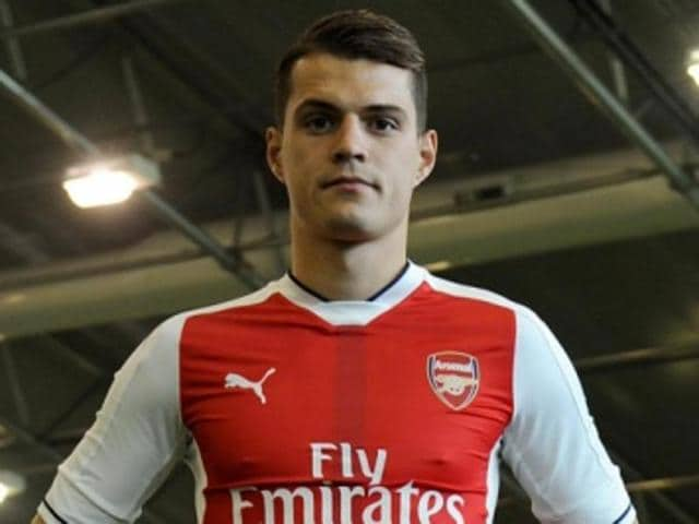 Granit Xhaka poses in Arsenal colours.