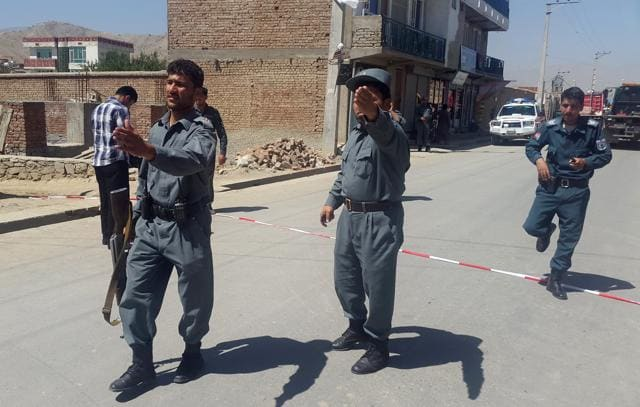 More than 20 people were killed in separate bomb attacks in Afghanistan on Monday when a suicide bomber struck a minibus carrying Nepali security contractors in the capital Kabul, officials said.