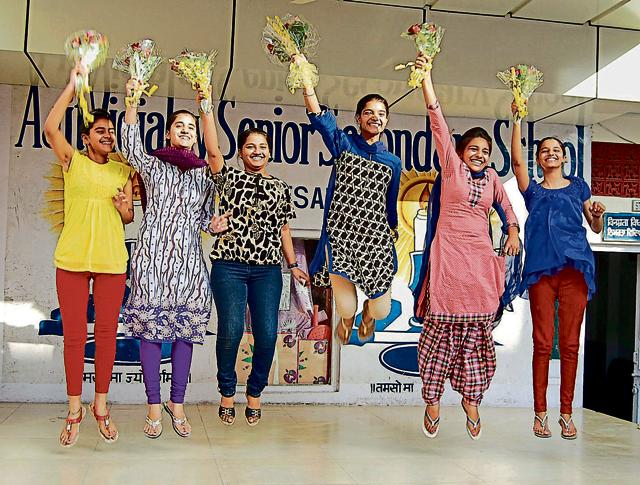 Meritorious students of Ajit Vidyalaya Senior Secondary School celebrating their success in Amritsar on Tuesday.(Sameer Sehgal/HT)