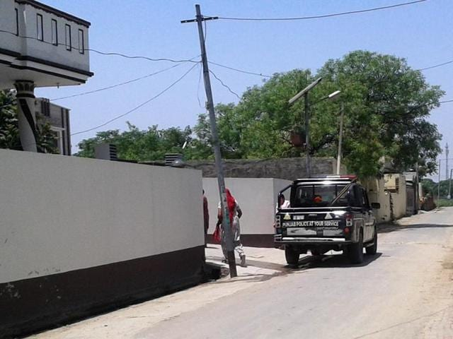 Police outside the house in Pallia Khurd village of Nawanshahr district from where cops seized the passports of one of the alleged terrorists, Arvinder Singh.