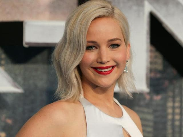 Jennifer Lawrence poses on arrival for the premiere of X-Men Apocalypse.