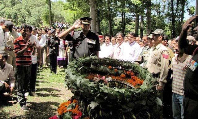 Army officials pay their respects to slain Assam Rifle officer Bhupender at Gohar village in Manipur on Wednesday. He was killed during a skirmish with insurgents in the state.