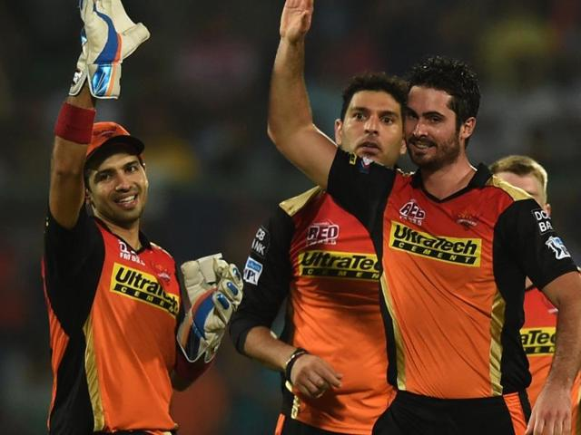 Sunrisers Hyderabad's Ben Cutting (R) celebrates with teammates.