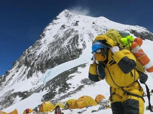 A porter carries goods at camp four at Everest, in this picture taken on May 20, 2016.
