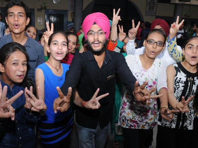 Students of Sun Flower High School in a jubilant mood after the declaration of the Punjab School Education Board Class-10 results, in Patiala on Tuesday.