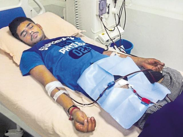 Arun Kumar undergoing treatment at a private hospital in Jalandhar on Tuesday.