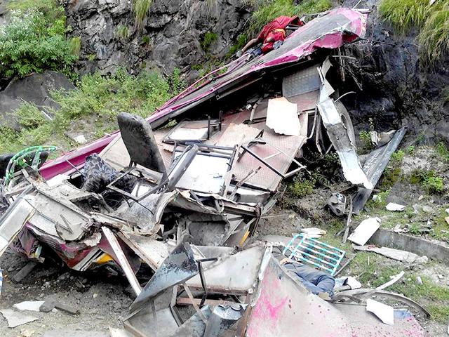The mangled remains of a bus after it skidded off the road and fell into a deep gorge.