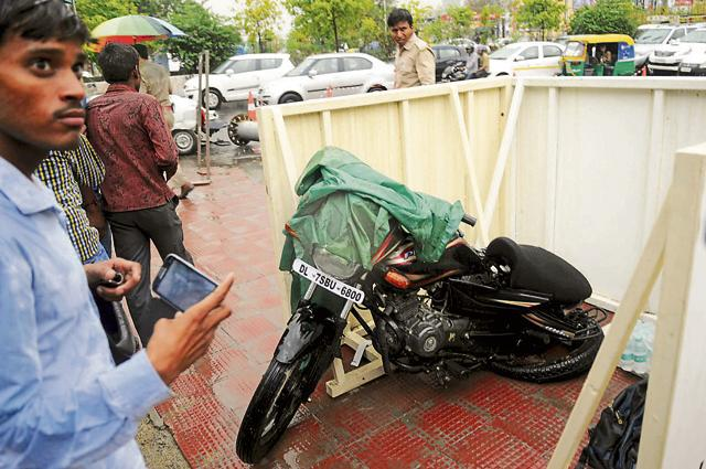 The bike on which Pushpender and Munna Kumar were riding on when the signage board collapsed on them.
