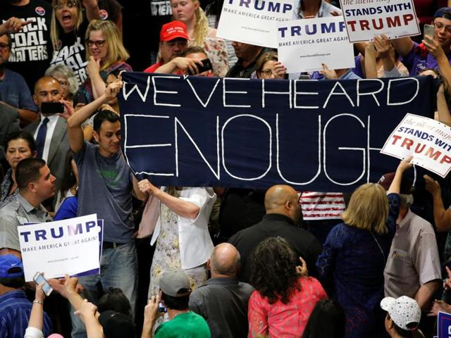 Protesters disrupt a rally by Republican US presidential candidate Donald Trump and his supporters in Albuquerque, New Mexico.