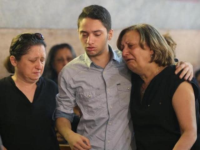The Imam of al Thawrah Mosque, Samir Abdel Bary, gives condolences to Tarek Abu Laban (centre), who lost four relatives in the EgyptAir plane crash.