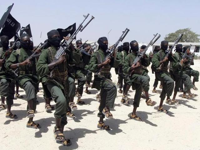 File photo of  al-Shabab fighters performing  military exercises in the Lafofe area in Somalia.