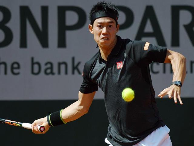 Japan's Kei Nishikori returns the ball to Russia's Andrey Kuznetsov during their men's second round match.