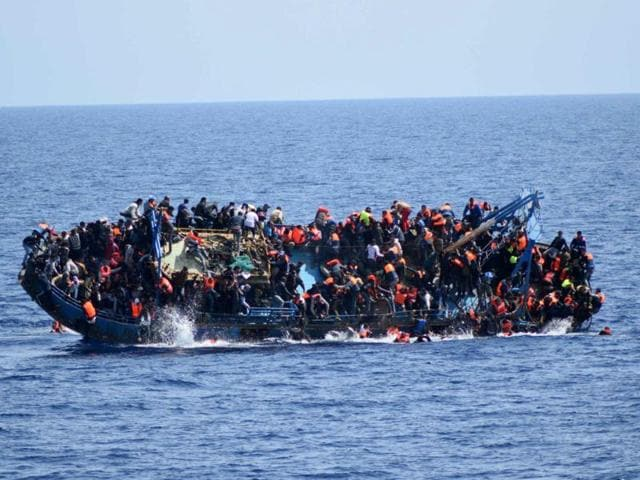 This handout picture by the Italian Navy shows the shipwreck of an overcrowded boat of migrants off the Libyan coast.
