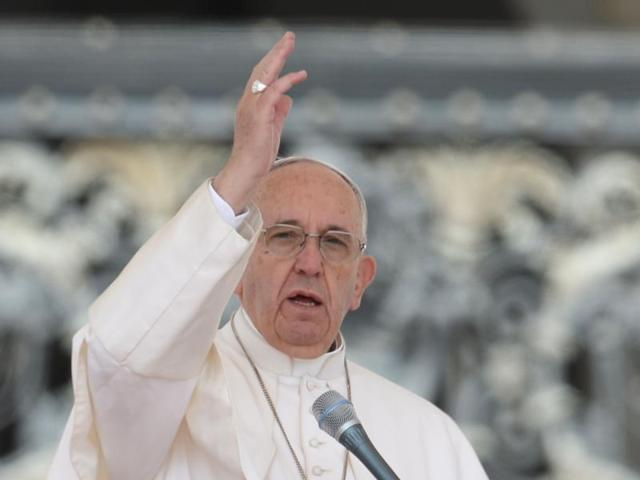 Pope Francis blesses the crowd at the end of his weekly general audience at St Peter's square on Wednesday.