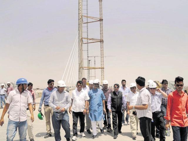 Kota MP Om Birla and NHAI officials inspect the bridge construction in Kota on Wednesday.