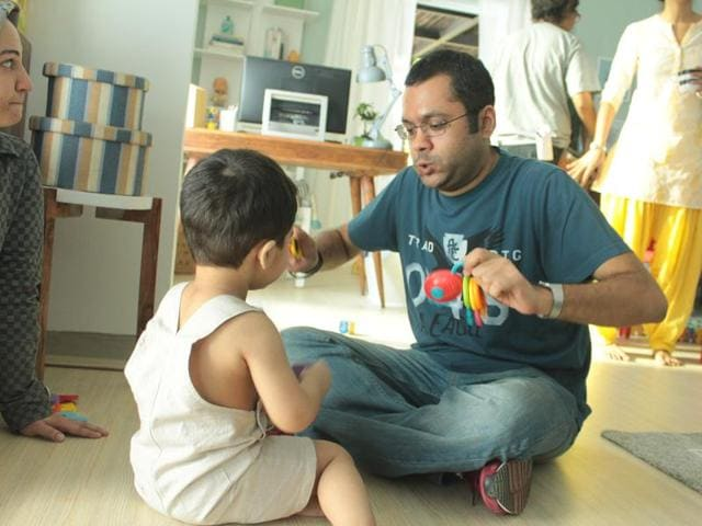 Ad filmmaker Nishant Goyal entertains the young star of a child nutrition brand commercial during a shoot.