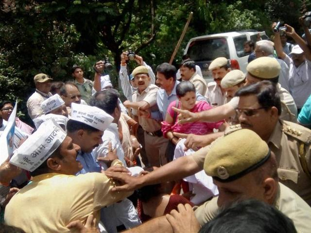 Police intervene as AAP volunteers clash with  students in Varanasi on Wednesday.