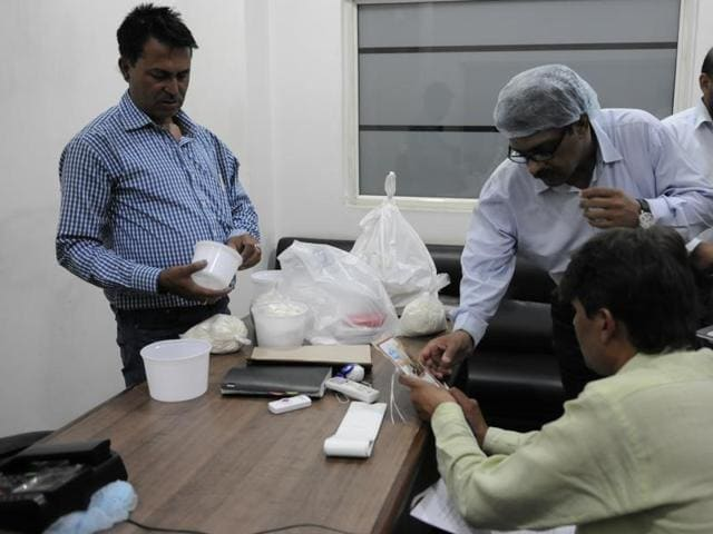 FDA officials collect samples from Top-N Town bread factory on Wednesday in Govindpura area, Bhopal.