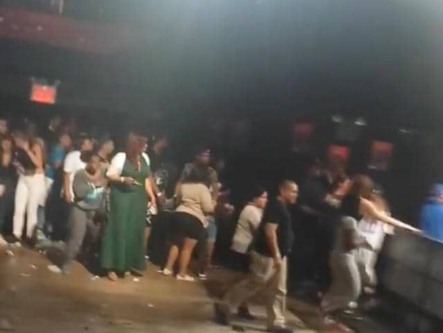 This image made from a video shows people inside Irving Plaza, near Manhattan's Union Square in New York after a shooting.