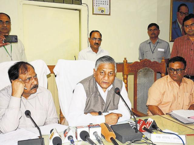 General (retd) VK Singh (centre) addresses a press conference in Ghaziabad on Wednesday with district magistrate Vimal Kumar Sharma (left) and GDA vice-chairman Vijay Kumar Yadav (right).