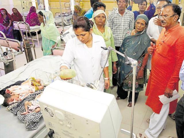Education minister Vasudev Devnani visits children in ICU ward of JLN Hospital in Ajmer.