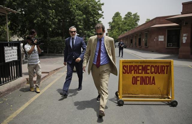 Members from the Italian delegation leave the Supreme Court complex in New Delhi on Thursday. The SChas allowed Italian marine Salvatore Girone to return home while international arbitration takes place over a 2012 fatal shootings of two Indian fishermen in which he and a fellow marine are implicated.